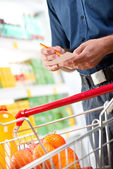 Checking shopping list — Stock Photo