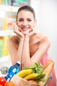Woman shopping with hands on chin — Foto Stock