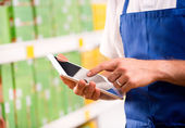 Sales clerk using tablet — Stock Photo