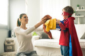 Little superhero helping his mother — Stock Photo