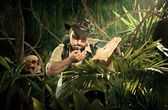 Explorer lost in jungle — Stock Photo