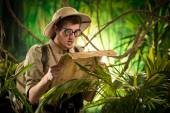 Lost explorer with old map — Stock Photo