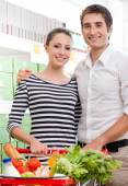 Happy young couple at supermarket — Stock Photo