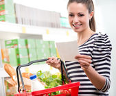 Woman with shopping list — Stock Photo