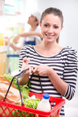 Attractive woman shopping at store — Stock Photo