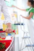 Customer at supermarket hands close-up — Stock Photo