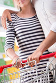 Couple at supermarket hands close-up — Stock Photo