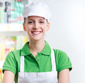 Female sales clerk working at supermarket — Stock Photo