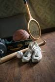 Vintage suitcase with sports equipment — Stock Photo