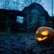 Halloween pumpkin with ancient gate — Stock Photo #52849605