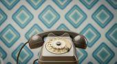 Vintage telephone on diamond wallpaper — Stock Photo