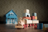 Wooden toy train and doll house — Stock Photo