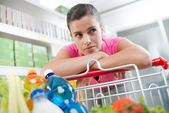 Exhausted woman at supermarket — Stock Photo
