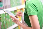 Sales clerk using tablet — Stock Photo