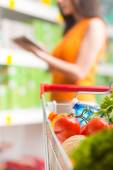 Using food app at store — Stock Photo