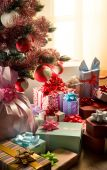 Traditional christmas tree with gifts — Stock Photo