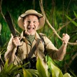 Постер, плакат: Cheering survival explorer in the jungle