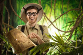 Explorer finding the right path in the jungle — Stock Photo