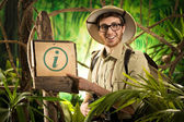 Cheerful explorer with sign — Stock Photo