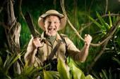Cheering survival explorer in the jungle — Stock Photo