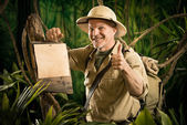 Cheerful explorer thumbs up with sign — Stock Photo