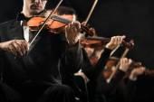 Violin orchestra performing — Stock Photo