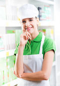 Attractive clerk with hand on chin — Foto Stock
