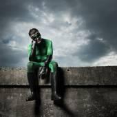 Pensive green superhero — Stock Photo