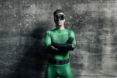 Confident superhero standing with arms crossed — Stock Photo