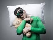 Superhero sleeping on a pillow floating in the air — Stock Photo