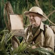 Explorer looking for toilet in jungle — Stock Photo #54948495