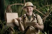 Adventurer with digital tablet — Stock Photo