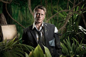Lost scared businessman in jungle — Stock fotografie