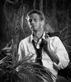 Depressed businessman lost in jungle — Stock fotografie