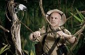 Explorer walking in jungle — Stock Photo