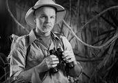 Explorer holding binoculars — Stock Photo