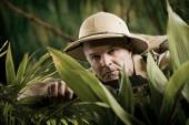 Adventurer exploring the rainforest jungle — Stock Photo