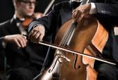 Cello player with symphony orchestra — Stock Photo