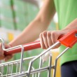 Woman pushing shopping cart — Stock Photo #54969135