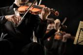 Violin orchestra performing — Stock Photo