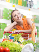 Pensive woman at store — Foto Stock