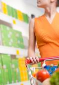 Woman looking at products on shelf — Stock Photo