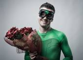 Romantic superhero holding roses — 图库照片