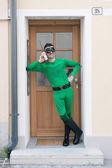 Cheerful superhero on phone — Stock Photo