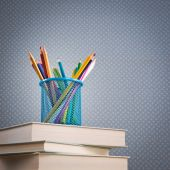 Stack of books with wooden pencils — Stock Photo