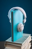 Book with headphones — Stock Photo