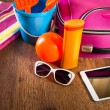 Tablet and colorful luggage — Stock Photo #55002631