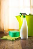 Spray detergent with green bucket — Stock Photo