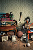 Assorted vintage items in attic — Stock Photo