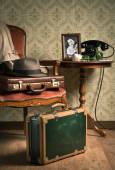 Hat and suitcases on elegant armchair — Stock Photo